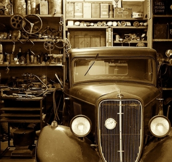 A vintage photo of an old car on display
